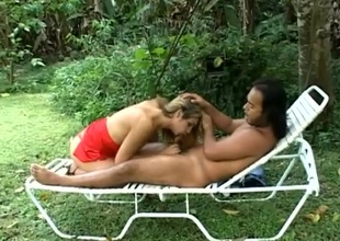 Attractive shemale giving mesmerizing blowjob vanguard having the brush anal drilled doggystyle alfresco