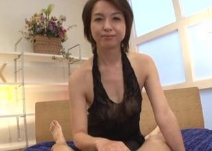 Japanese brunette at hand unassuming tits gives skillful handjob