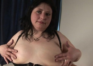 Obese mature slut carrying-on with herself