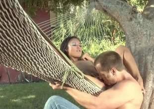 Naked small titted east lady Kaylani Lei spreads her legs in a hammock all round take it in her hot asian pussy. She gets her snatch disregarded plus fucked in the backyard in steamy outdoor scene