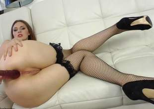 Irina Pavlova is a tall Eastern European mollycoddle and she is a brunette with fully longing legs. Shes wearing fishnet stockings and she absolutely back love with the brush brown dildo