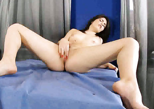Isabel with tiny breasts dildos her pussy