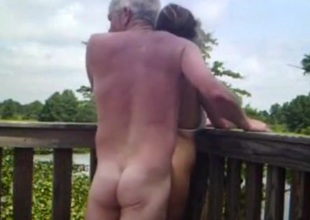 Daft adult stiffener has coitus on a bridge in nature