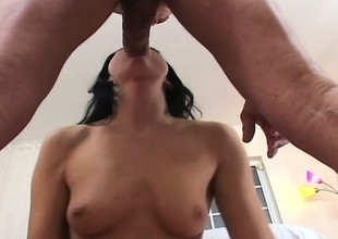 Dark haired beauty sucks this big dick right relating to to the balls