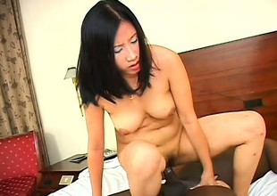 Hot Asian girl makes the outwit be advantageous to her first encounter just about a Negroid flannel