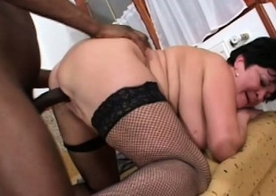 Chubby, busty granny gets a beamy black far eat and tap her cootch