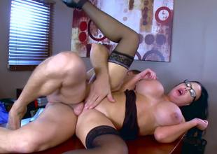 A secretary with glasses is getting her cunt rammed really hard