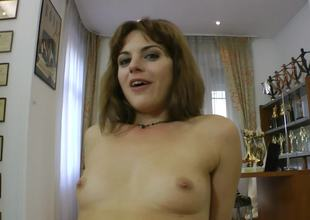 A brunette with short hair and small tits is getting penetrated