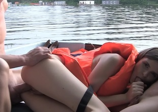 Hardcore on a boat with a cutie in a circumscribe vest