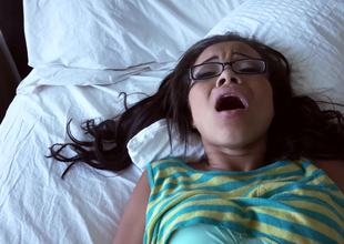 A hot thing with glasses is giving a blow job beyond everything the bed